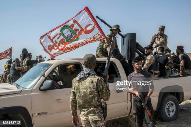 Soldiers of the Hashd AlShaabi prepare to fight in an offensive to drive out Islamic State militants on September 24 2017 in Hawija Iraq The Hashd...