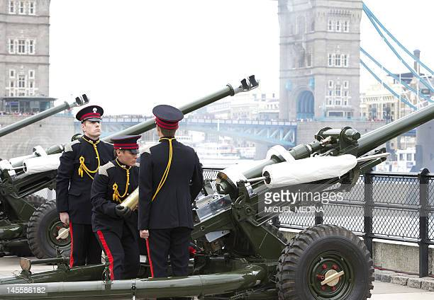 Soldiers of the Honorable Artillery Company prepare to fire blank rounds during a 62 gun salute at the Tower of London on June 2 to mark the start of...