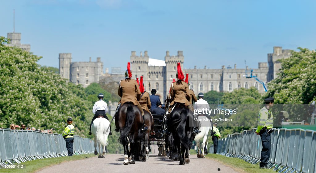 Soldiers of the Household Cavalry follow the Ascot Landau carriage pulled by four Windsor Grey Horses (which will carry Prince Harry and Meghan Markle through Windsor following their wedding) down the Long Walk during a military dress rehearsal for the wedding of Prince Harry and Meghan Markle at Windsor Castle on May 17, 2018 in Windsor, England.