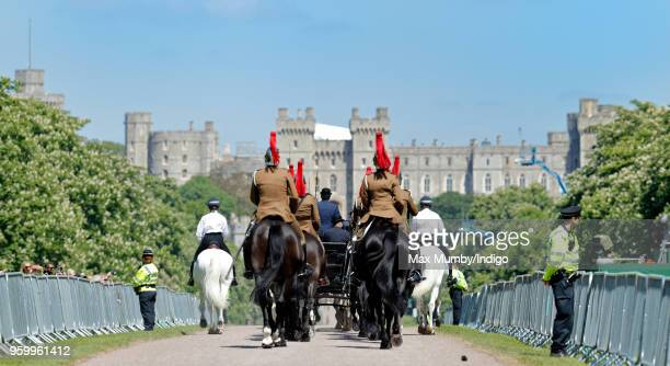 Soldiers of the Household Cavalry follow the Ascot Landau carriage pulled by four Windsor Grey Horses down the Long Walk during a military dress...