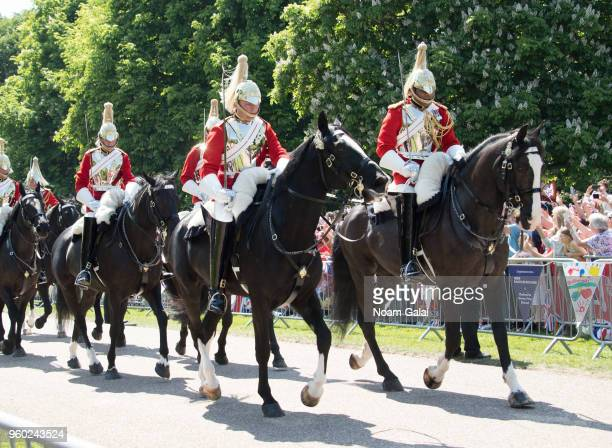 Soldiers of the Household Cavalry ride on their horses in front of the Ascot Landau carriage during the procession For Prince Harry and Meghan Markle...