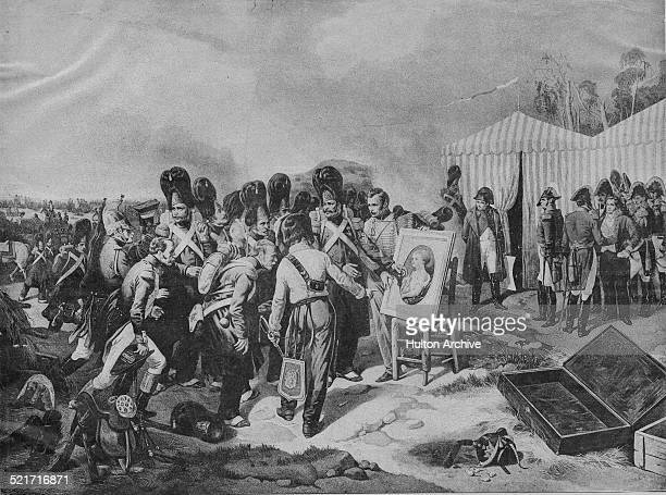 Soldiers of the Imperial Guard of the French Grande Armee gather to look at the portrait by Francois Gerard of the baby Napoleon II the King of Rome...