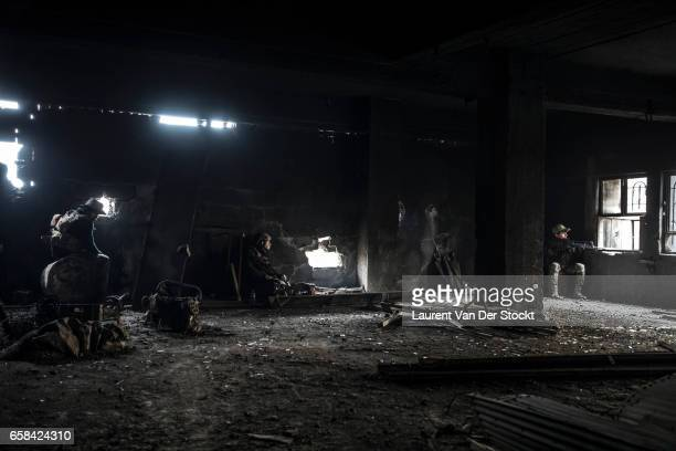 Soldiers of the Iraqi Federal Police Emergency Response Division during a battle on their last position of the Wednesday Market on the frontline...