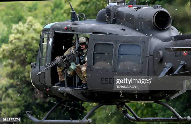Soldiers of the Italian Army sit in a helicopter during a military exercise at a training camp in Cesano near Rome on May 21 2018