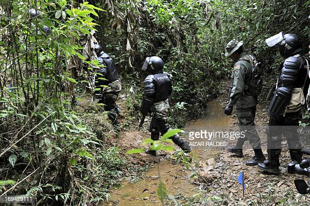 Soldiers of the Joint Task Force head to an open field in the jungle to destroy coca plantations in the Madidi National Park in northeastern Bolivia...