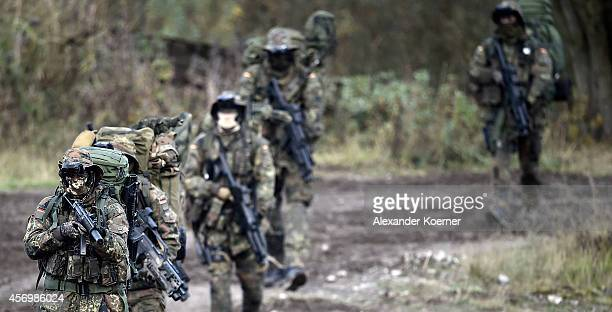Soldiers of the Long Range Reconnaissance Patrol of the German Armed Forces march during an exercise prior the arrival of German Defense Minister...