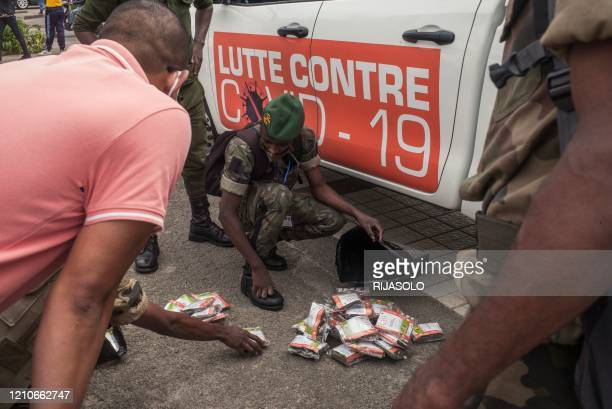 Soldiers of the Malagasy army are gathered on the square in front of the Town Hall in Antananarivo on April 22 to receive stocks of a local herbal...