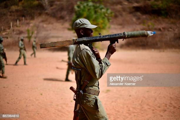 A soldiers of the Malian Armed Forces marches with a makeshift rocket launcher during a tactical training on March 10 2017 in Koulikoro Mali The...