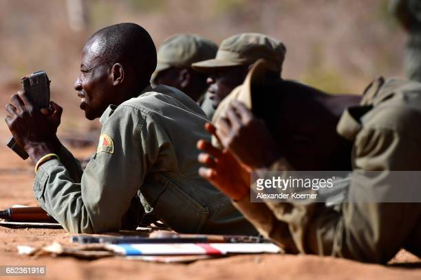 Soldiers of the Malian Armed Forces prepare to shoot with an AK47 rifle and live ammunition at the shooting range at a training base on March 09 2017...