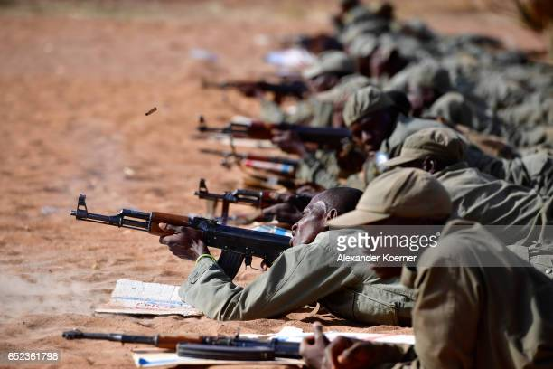Soldiers of the Malian Armed Forces shoot with an AK47 rifle and live ammunition at the shooting range at a training base on March 09 2017 in...