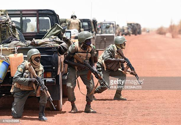 Soldiers of the Malian Army Forces secure the pist between Goundam and Timbuktu northern Mali on June 2 during the joint operation 'La Madine 3' part...