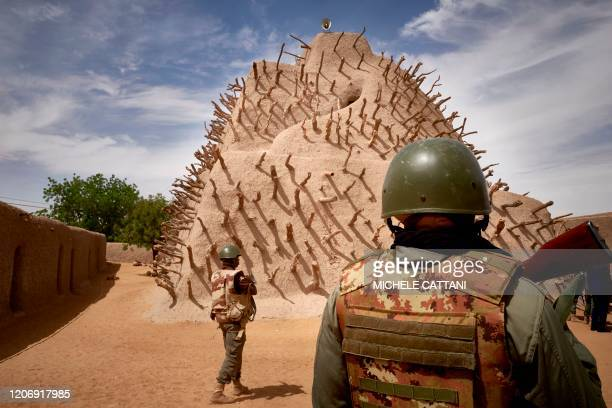 Soldiers of the Malian army patrol the archaeological site of the Tomb of Askia in Gao on March 10, 2020. - The site, which was protected during the...