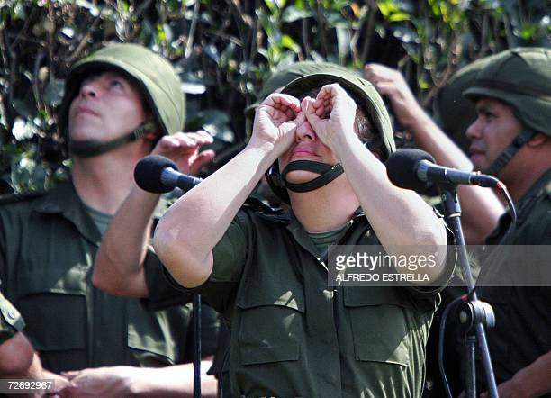 Soldiers of the Mexican Army look at the sky during a militar parade at the Campo Marte in Mexico City December 1st 2006 on the framework of the...