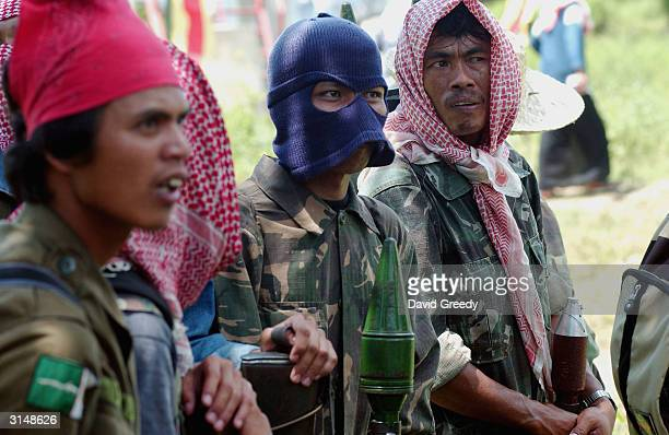 Soldiers of the Moro Islamic Liberation Front stand gaurd at the Islamic Center in Buliok, on March 28, 2004 on the southern island of Mindanao,...