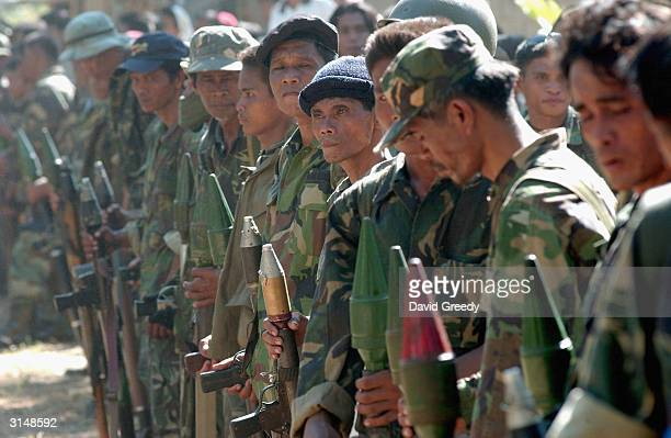 Soldiers of the Moro Islamic Liberation Front stand guard at a camp in Tolitay on March 28 2004 on the southern island of Mindanao Philippines More...