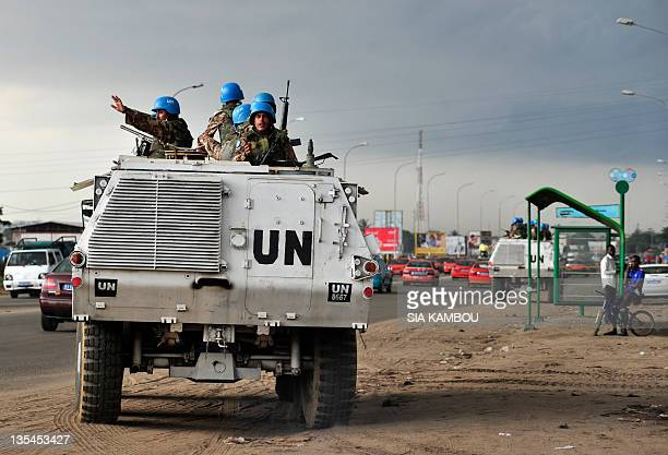 Soldiers of the peacekeeping operation in Ivory Coast stand in armored carriers on December 10, 2011 on the road leading to the Abidjan airport to...