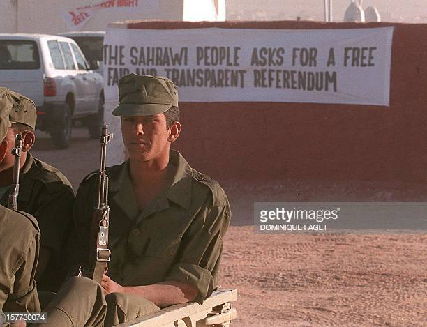 Soldiers of the Polisario front stand in a car in Samra's refugees camp 30 November in Tindouf Algeria A ceasefire in the conflict opposing the...
