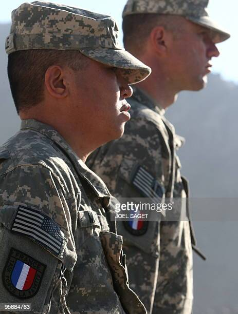 US soldiers of the PRT receive their French insignia patches following their integration in the French Task force La Fayette at Forward Operating...