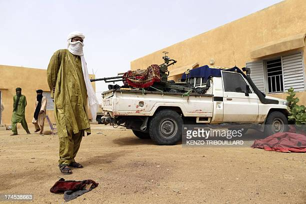 Soldiers of the rebel National Movement for the Liberation of Azawad pose at their headquarters on July 27 2013 in the northern Malian city of Kidal...