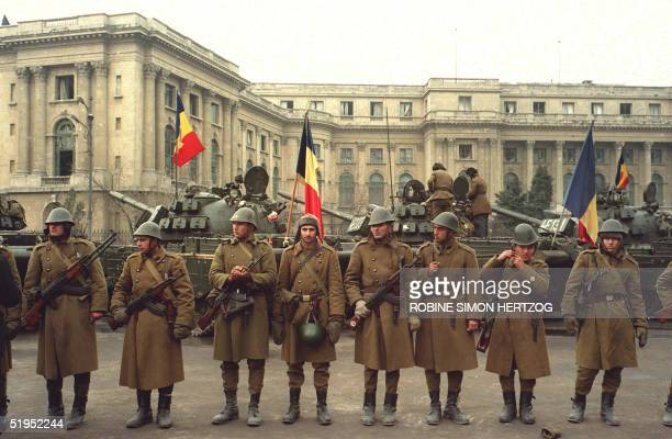 Soldiers of the Romanian army and tanks guard the Central Committee headquerters 26 December 1989 in Bucharest one day after Romanian leader Nicolae...