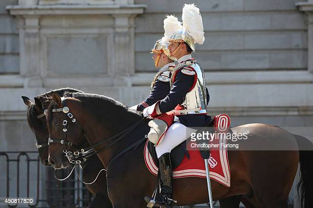 Soldiers of the Royal Guard parade outside the Royal Palace as King Juan Carlos prepares to sign the official abdication papers on June 18 2014 in...