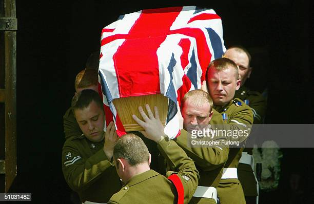 Soldiers of The Royal Highland Fusiliers carry the coffin of Fusilier Gordon Gentle during his funeral at St James' Parish Church on July 7 in Pollok...