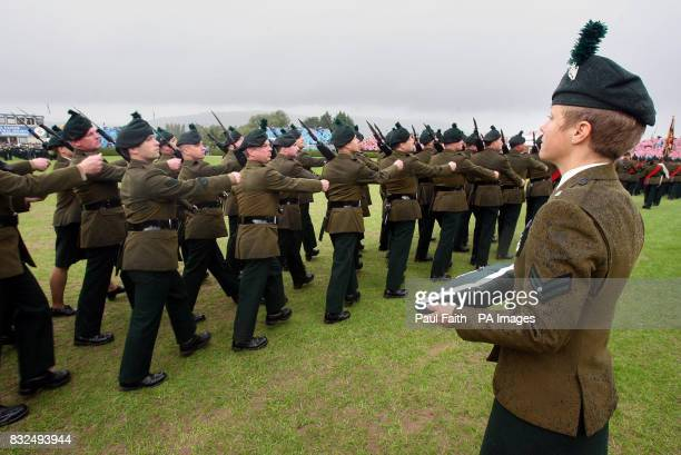 Soldiers of the Royal Irish Regiment march past Coporal Claire Withers, who holds the Conspicuous Gallantry Cross presented by the Queen, at Balmoral...