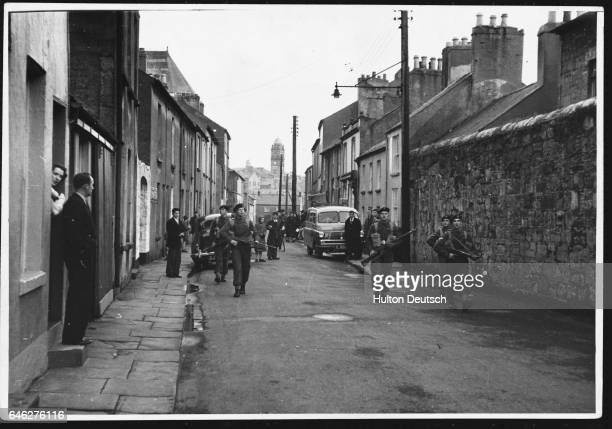 Soldiers of the Royal Warwick regiment patrol a street in Enniskillen They are guarding a nearby radar station