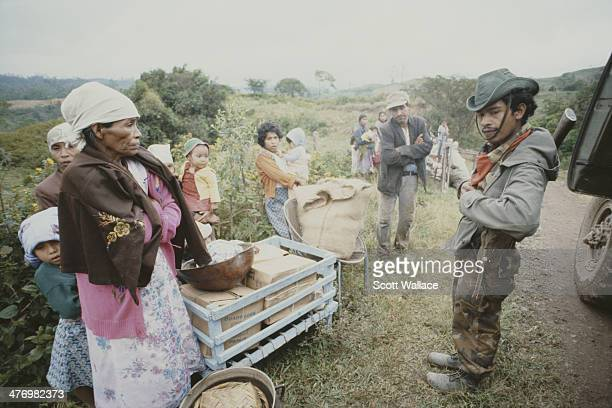 Soldiers of the Sandinista Popular Army conduct the forced evacuation of peasants El Ventarron Nicaragua 1985
