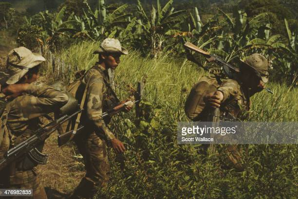 Soldiers of the Sandinista Popular Army crossing a field Nicaragua 1985