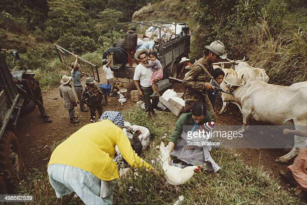 Soldiers of the Sandinista Popular Army forcibly evacuating peasants from their homes in El Ventarrón Nicaragua during a period of intense fighting...