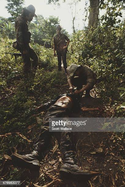 Soldiers of the Sandinista Popular Army with the dead body of a contra guerilla Nicaragua 1985