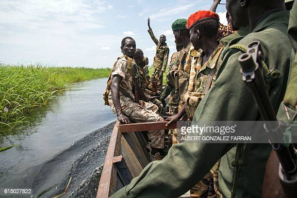 TOPSHOT Soldiers of the Sudan People Liberation Army cross the Nile River in a boat near Malakal northern South Sudan on October 16 2016 Heavy...