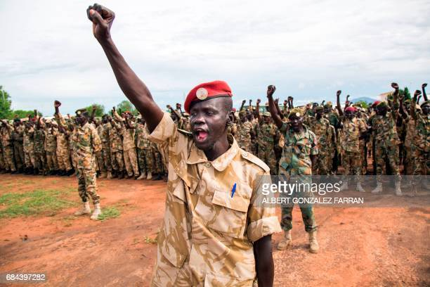 TOPSHOT Soldiers of the Sudan People's Liberation Army cheer cheer during the commemoration of Sudan People's Liberation Army Day at the SPLA...