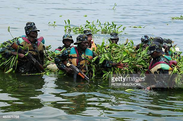 Soldiers of the Uganda People's Defence Marine Force take part on July 18 2014 in a passing out ceremony at the Marine Training School at the...
