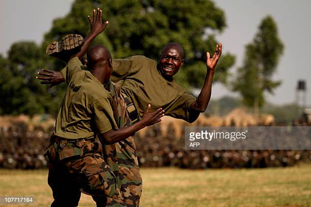 Soldiers of the Uganda people's defences forces display their martialarts skills during their 'passout' ceremony at the Singo military camp on...