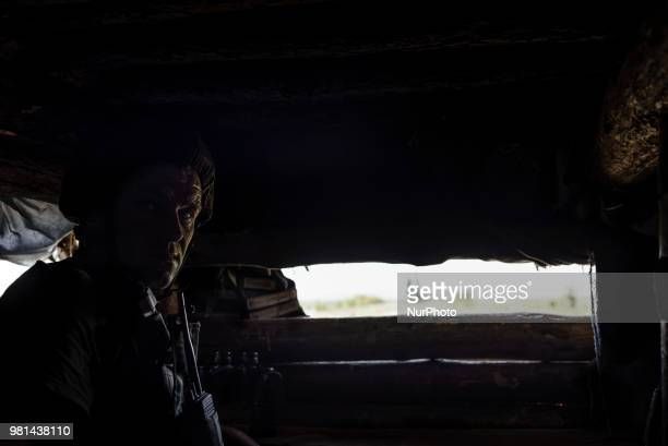 Soldiers of the Ukrainian army on the front line during the Joint Forces Operation in Donbass area Luhansk region Ukraine on June 2018 During the...