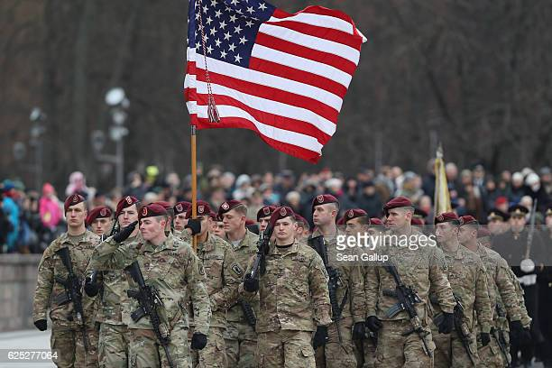 Soldiers of the US 173rd Airborne Brigade participate in a parade in the city center during the Iron Sword multinational military exercises on...