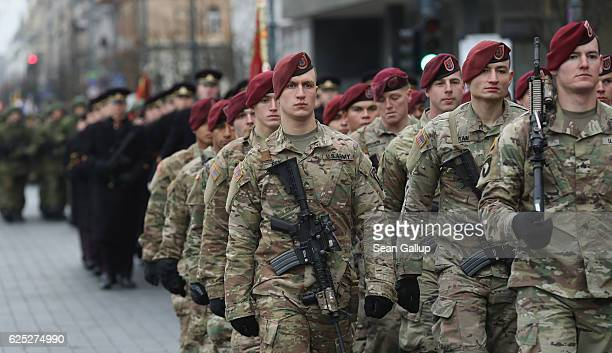 Soldiers of the U.S. 173rd Airborne Brigademarch in a parade in the city center during the Iron Sword multinational military exercises on November...