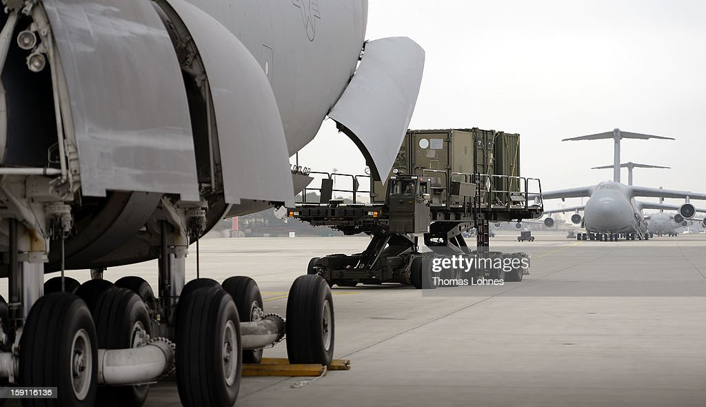 Soldiers of the U.S. Army Europe's 10th Army Air and Missile Defense Command, who operate Patriot anti-missile systems, load cargo on board a plane C-5 Galaxy for Turkey at Ramstein Air Base on January 8, 2012 near Ramstein-Miesenbach, Germany. The troops are deploying along with Patriot batteries from Netherlands and Germany as part of a NATO operation called 'Active Fence Turkey' meant to protect Turkey, which is also a NATO member state, from possible missile attack from Syria.