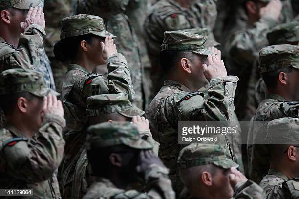 Soldiers of the US Army V Corps conduct a color casing ceremony to mark the departure of V Corps headquarters from Europe on May 10 2012 at the US...