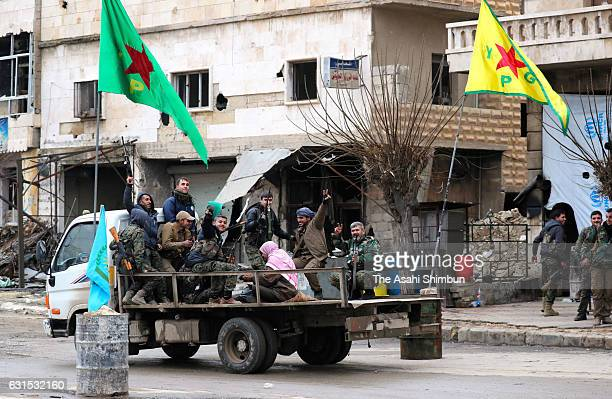 Soldiers of the YPG Kurdish People's Protection Units patrol near a border of Kurd occupied northern Aleppo on January 9 2017 in Aleppo Syria Bashar...