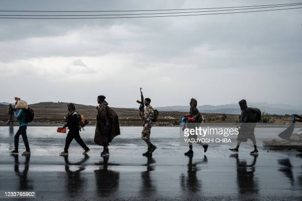 Soldiers of Tigray Defence Force walk in lines towards another field in Mekele, the capital of Tigray region, Ethiopia, on June 30, 2021. - Rebel...