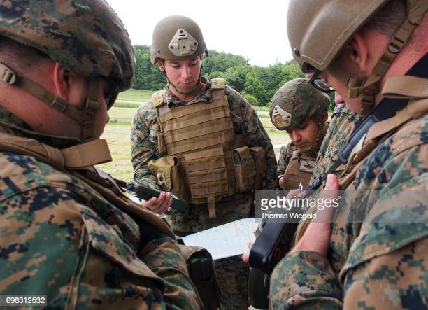 Soldiers of US Marines consult before an Amphibious Landing Exercise on June 08 2017 in Oldenburg Germany