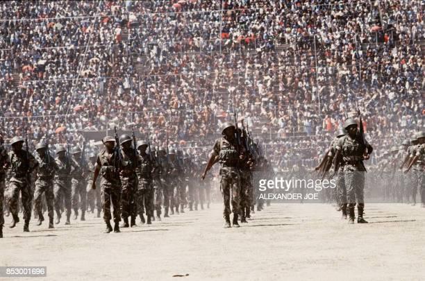 Soldiers of Zimbabwean army parades in May 1984 at the Rufaro stadium in Harare / AFP PHOTO / ALEXANDER JOE