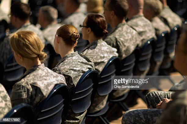 Soldiers officers and civilian employees attend the commencement ceremony for the US Army's annual observance of Sexual Assault Awareness and...