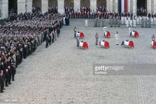 Soldiers, officials and relatives attend a tribute ceremony on December 2, 2019 at the Invalides monument, in Paris, for the 13 French soldiers...