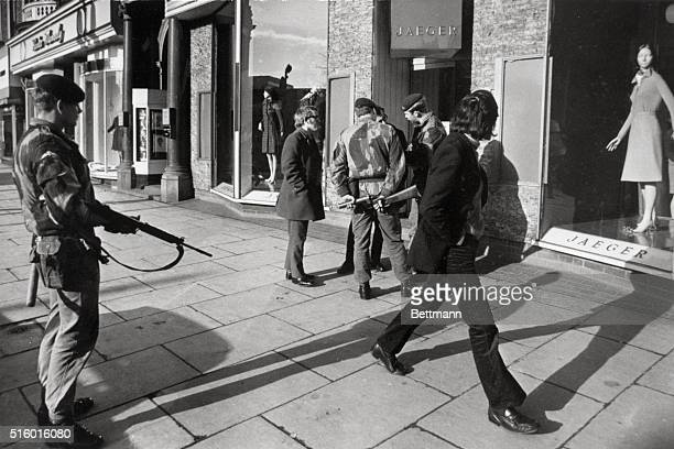 Soldiers often search civilians walking through downtown Belfast for firearms since terrorist activities began to rise in Northern Ireland.
