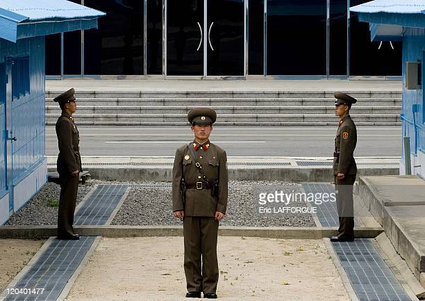Soldiers On 38Th Parallel in North Korea The Korean Demilitarized Zone KMZ is a strip of land running across the Korean Peninsula that serves as a...