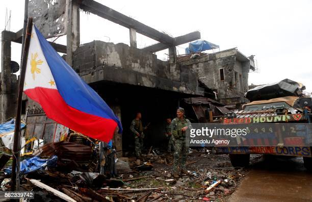 Soldiers on a battle damaged street in Marawi City in the Southern Philippines on October 17 2017 President Rodrigo Duterte on Tuesday declared the...